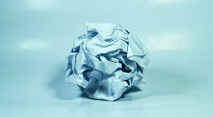 Image of Rolled Up Paper to Reflect Investment Mistakes